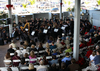 The Sarasota Orchestra performed to a large crowd in the courtyard of Mote Aquarium on Tuesday, Dec. 21.