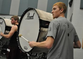 Lawrence Ingerly practices on the bass drum line.