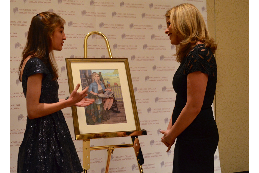 Ringling student Brenna Thummler talks to Jenna Bush Hager after presenting the speaker with the portrait.