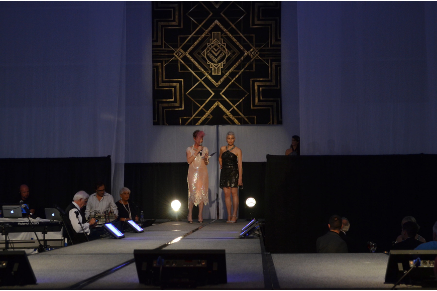 Chairwoman Marilee Roberts introduces designer Alice Bee before the runway show.