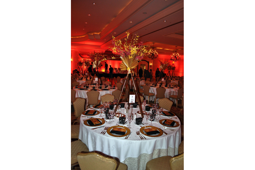 Each table had a beautiful centerpiece made from bamboo and orchids designed by Elegant Designs Floral Art Studio.