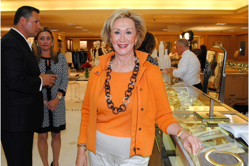 Elenor Maxheim trying on a one-of-a-kind necklace in the John Hardy Spring 2014 Collection.