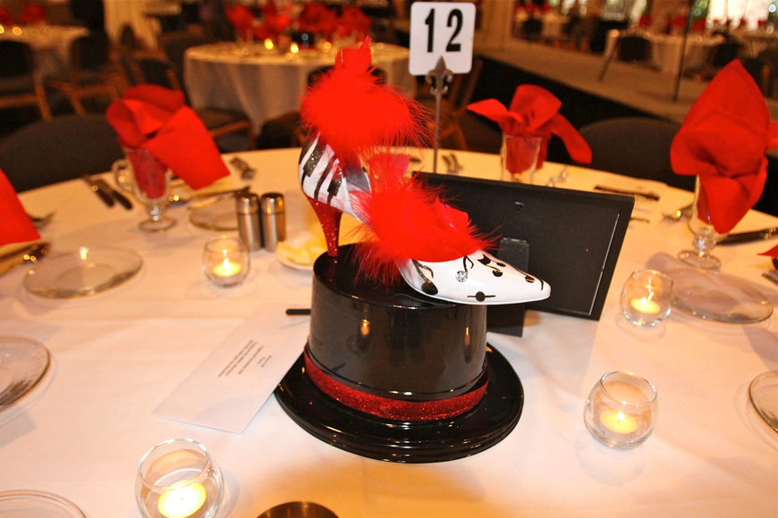 "Shoe No. 29 ""Piano"" was the centerpiece at table 12 and was designed by ABWA members Michelle Held and Lisa Donahue."