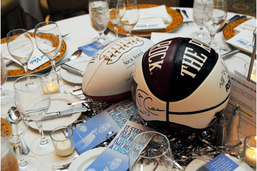 Signed basketballs and footballs were the table centerpieces at the 9th annual Dick Vitale Gala.