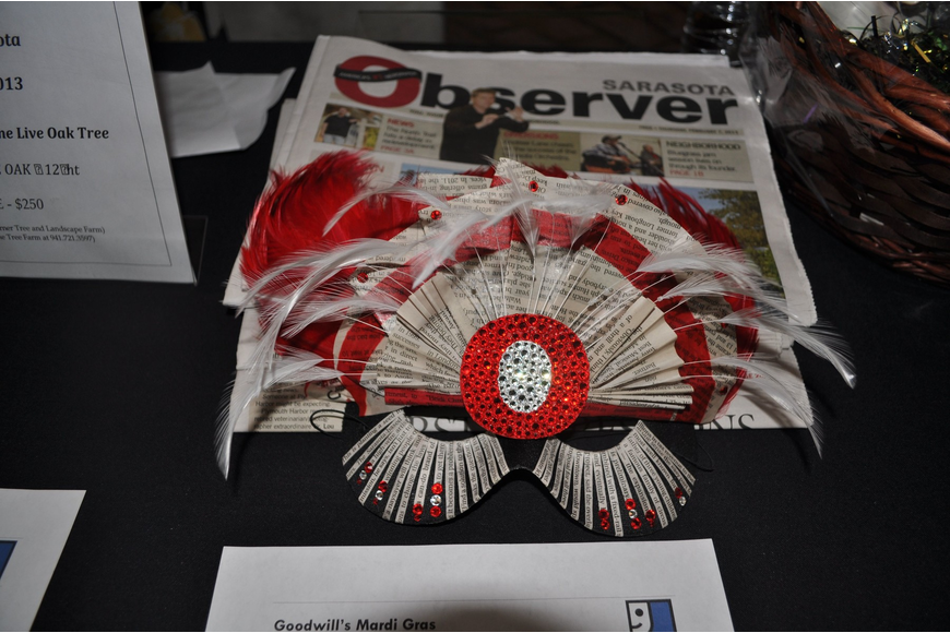 The Observer Media Group's Mardi Gras mask was up for auction.
