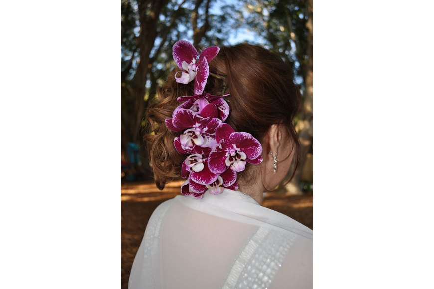 Debbie Seitl had her hair done up with orchids.