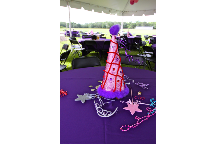 A table full of princess themed decorations.
