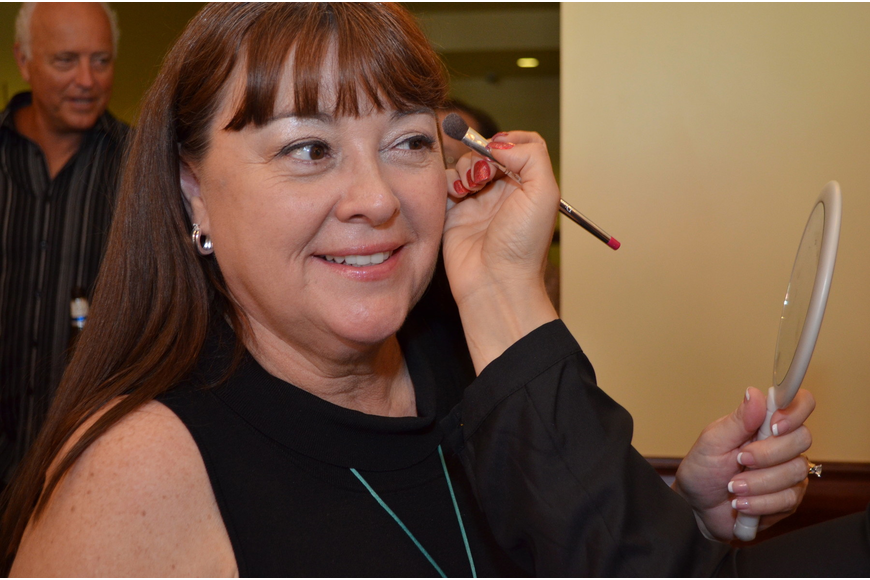 Rosemary Chapura gets her makeup done by Dior makeup artist, Sally Perron, at the Women's Council of Realtors Fashion and Luncheon Tuesday, Sept. 18.