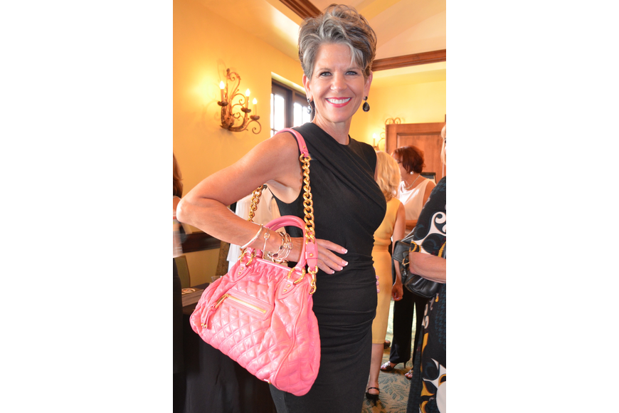 Sally Schule models the amazing Marc Jacobs bag Saks Fifth Avenue donated for the auction.