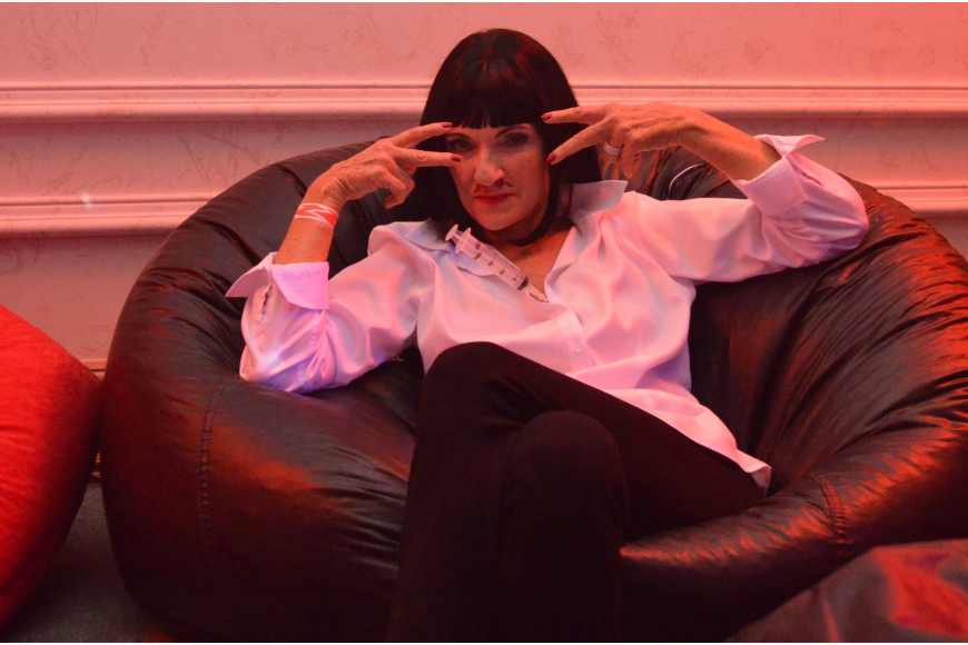 President/CEO of Planned Parenthood of Southwest and Central Florida Barbara Zdravecky lounges at the Safe Sex Halloween Bash as Mia from Pulp Fiction.