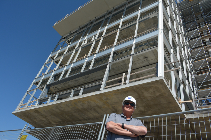 SANCA President Bob Sullivan stands in front of the new finish tower, which only needs windows and cosmetic work to be complete.