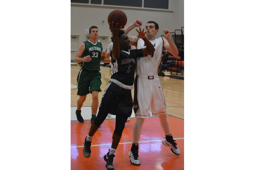Braden River'  s Deoni Cason bangs into Riverview'  s AJ Caldwell in the post during the boys game.