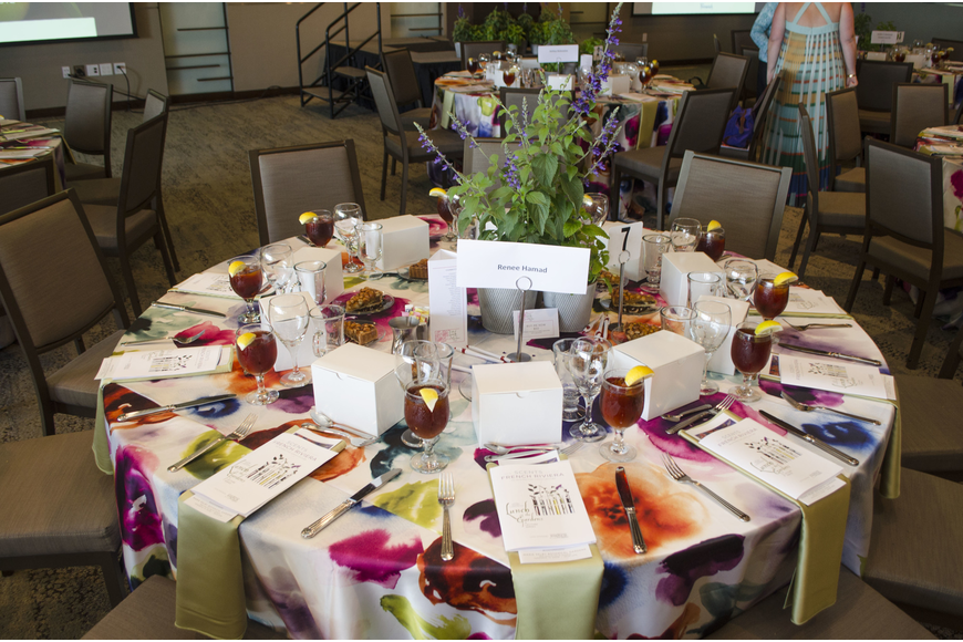 "Organizers adorned every table with vibrant watercolor-print tablecloths and floral centerpieces at Lunch in the Gardens: ""Scents of the French Riviera"" on April 19 at Michael's on the Bay at Selby Gardens."