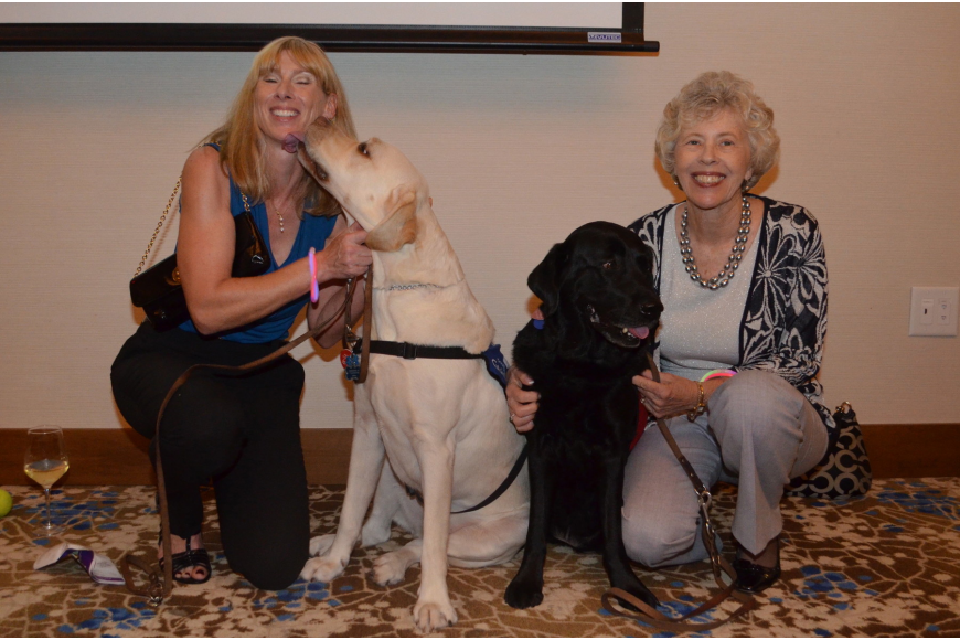 Susan Tone with her yellow lab Millard and Mary-Lou Moulton with her black lab Miss Fay