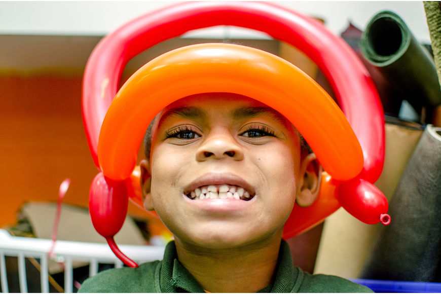 King smiles while showing off his balloon crown. Boys and Girls club participants enjoyed balloons, face paint and presentations by Mote Marine Aquarium and Sarasota County Fire Department after the ribbon cutting.