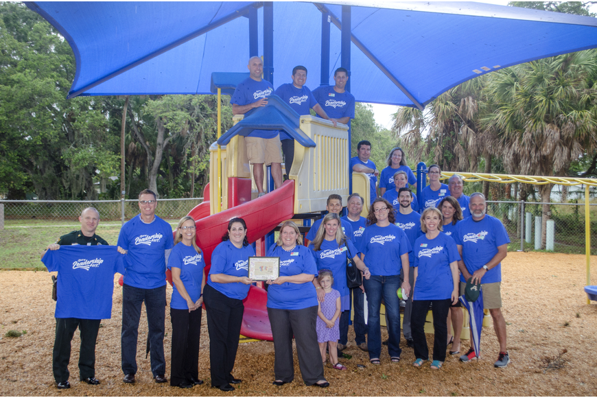 Leadership Sarasota County members pose under the sunshade they constructed for the Roy McBean Boys and Girls club.