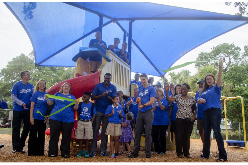 Leadership Sarasota and Boys and Girls Club members cut the ribbon on Project Play and Learn, which included a new sun shade for the play ground, new picnic tables and new benches.