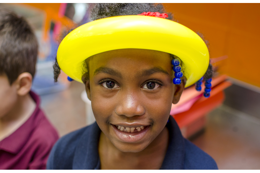 Gizaria shows off her balloon hat. Boys and Girls club participants enjoyed balloons, face paint and presentations by Mote Marine Aquarium and Sarasota County Fire Department after the ribbon cutting.