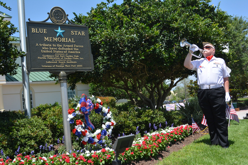 "Bugler John Veenstra plays ""Taps"" on Sunday at the end of a ceremony to dedicate a Blue Star Memorial Marker at Lakewood Ranch Town Hall."