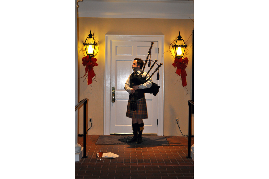 Ross Allen plays the bagpipe as guests arrived.