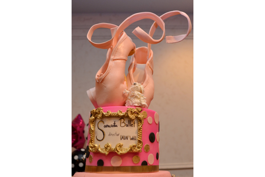 The cake for the celebration was topped with ballet slippers.