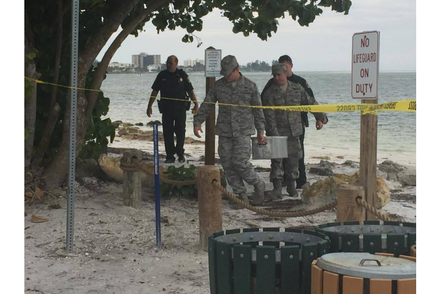 Military personnel from MacDill Air Force Base in Tampa arrived to retrieve the flare. Photo courtesy Sarasota County Sheriff's Office.