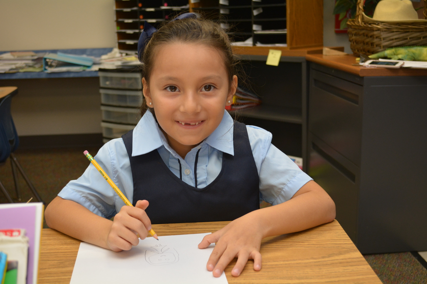 Valentina Oviedeo-Fajardo is all smiles for her first day of first grade at Willis Elementary.