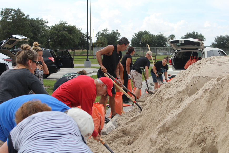 East County residents fill their sand bags at Lakewood Ranch Community Park on Wednesday.