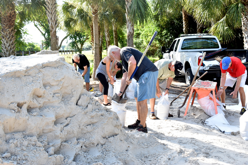 Longboat Key residents fill sandbags at the Broadway Street beach access.