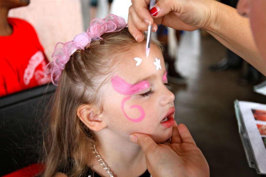 Vivian Hugill, 3, has her face painted.
