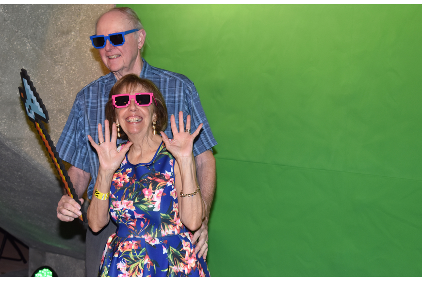Pat and Greg Reinhart take a turn in the photo booth at First Night RIAF 2017 on Oct. 18 at The Ringling.