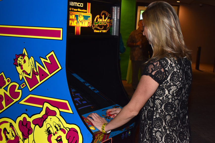 Amy Donnellan plays a game of Pac-Man at First Night RIAF 2017 on Oct. 18 at The Ringling.