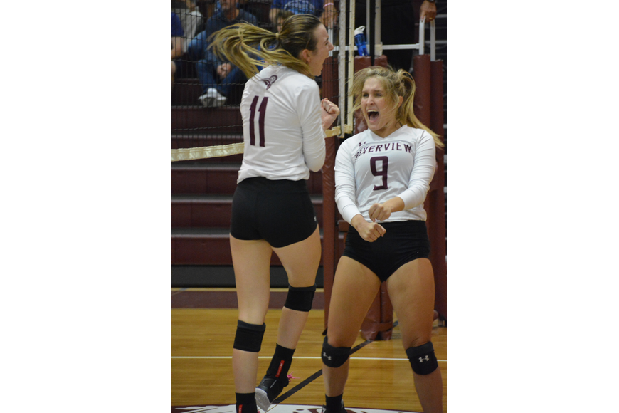 Abby Quigley and Kayla Walker scream in excitement after Quigley recorded a kill.