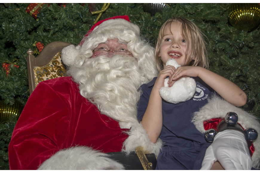Caitlin Cail poses with Santa during the Sarasota downtown tree lighting celebration