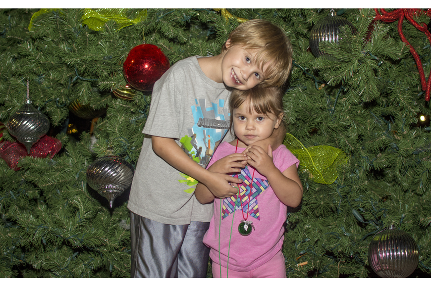 Jack and Allie Hilton pose in front of the tree in Five Points Park.