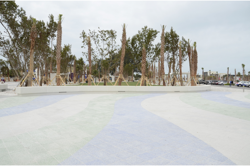 The east esplanade walkway is finished, featuring a blue, green and stone colored pattern.