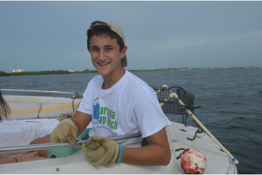 Jack Martin, 15, cleans a scallop.