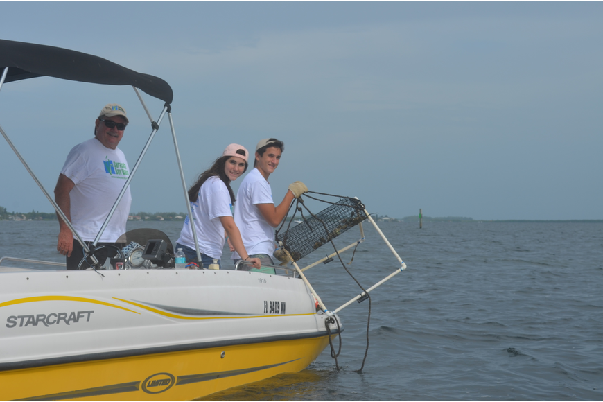 Steve, Ellie and Jack Martin check on a scallop sanctuary.