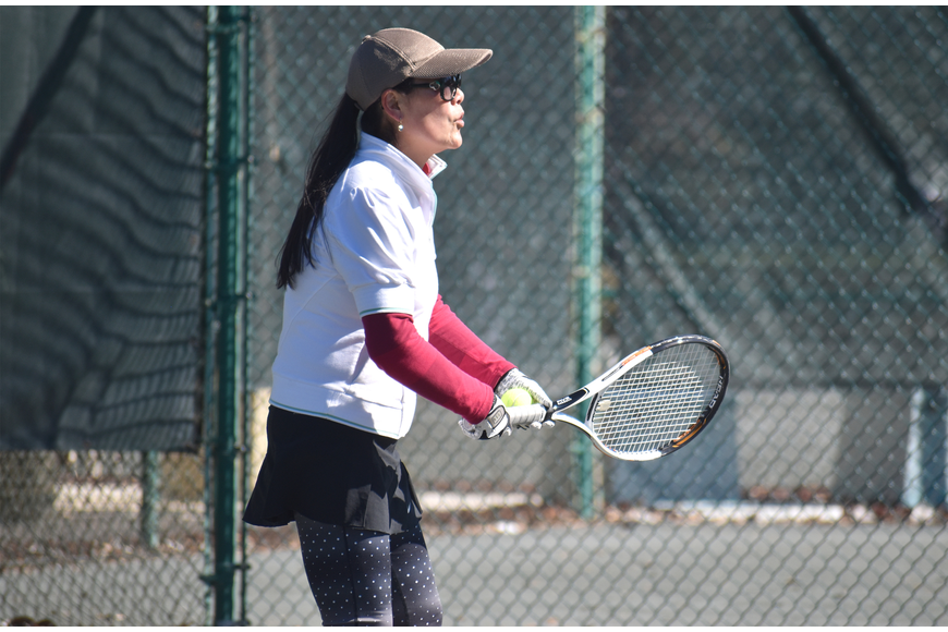 Ying Lee awaits the ball during a preliminary match.
