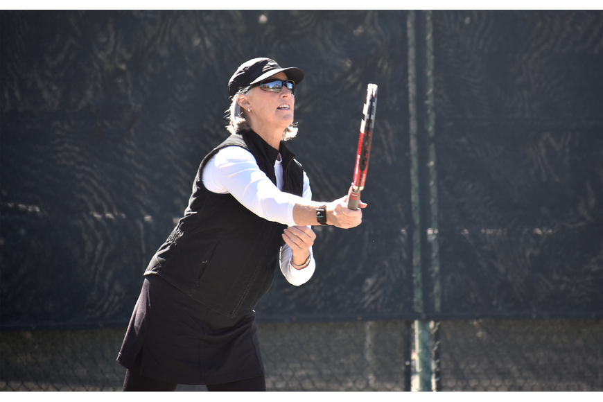 Jan Withers hits the ball during a preliminary match.