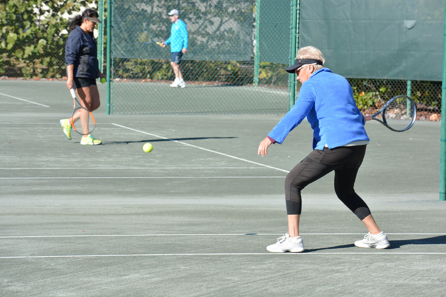 Cathy Powell returns a serve during the Division 2 mixed doubles match.