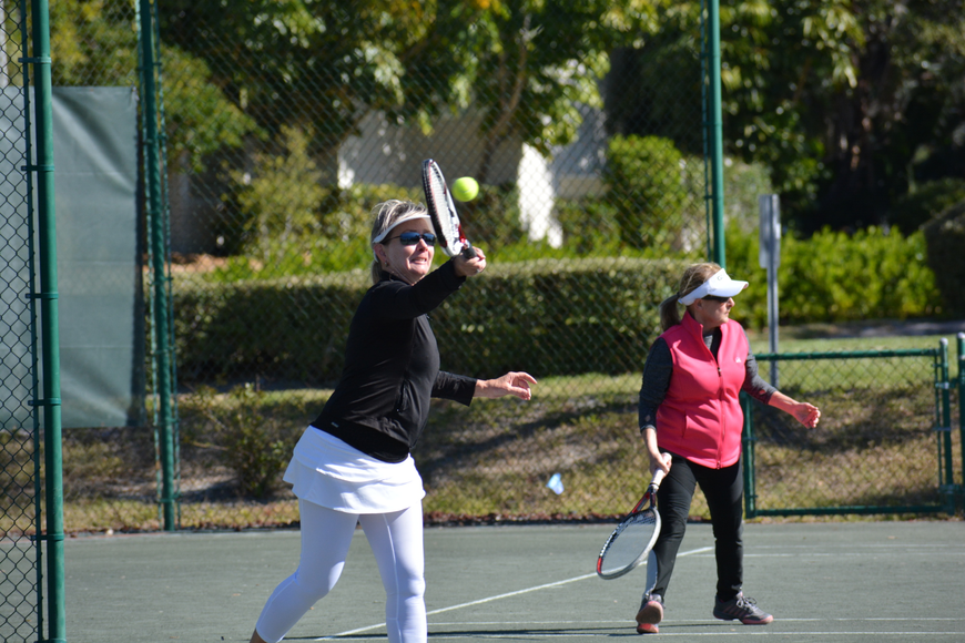Irene Langlois volleys during the Division 3 women's singles match Sunday.