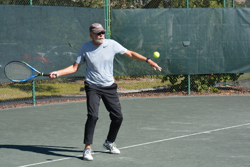 Fred Berg returns a serve in his Division 3 match Sunday.