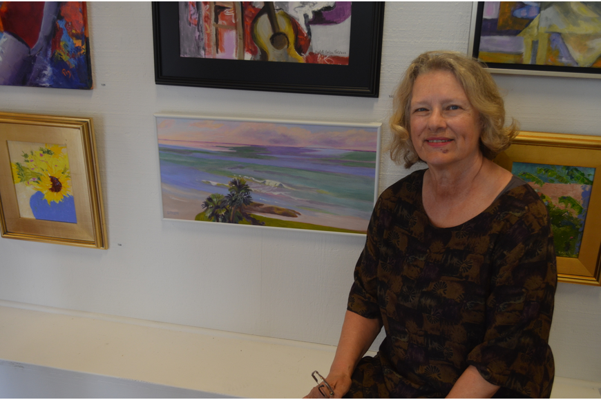 "Artist Linda Nimmer with her piece, ""Plein Aire from the 5th Floor of the Westchester,"" which received an Honorable Mention"