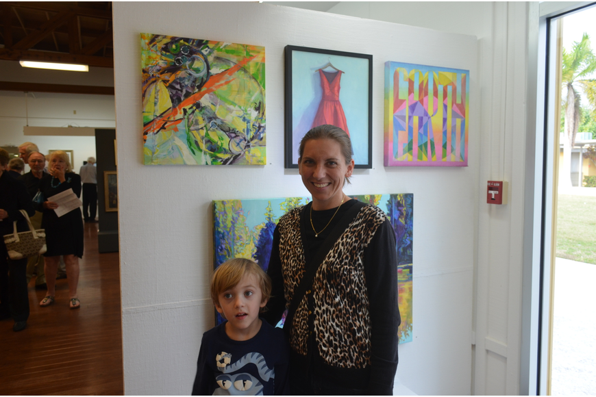 "Emmett, 4, and artist Julie Kanapaux in front of her work,  ""Within Reasonable Limits"""