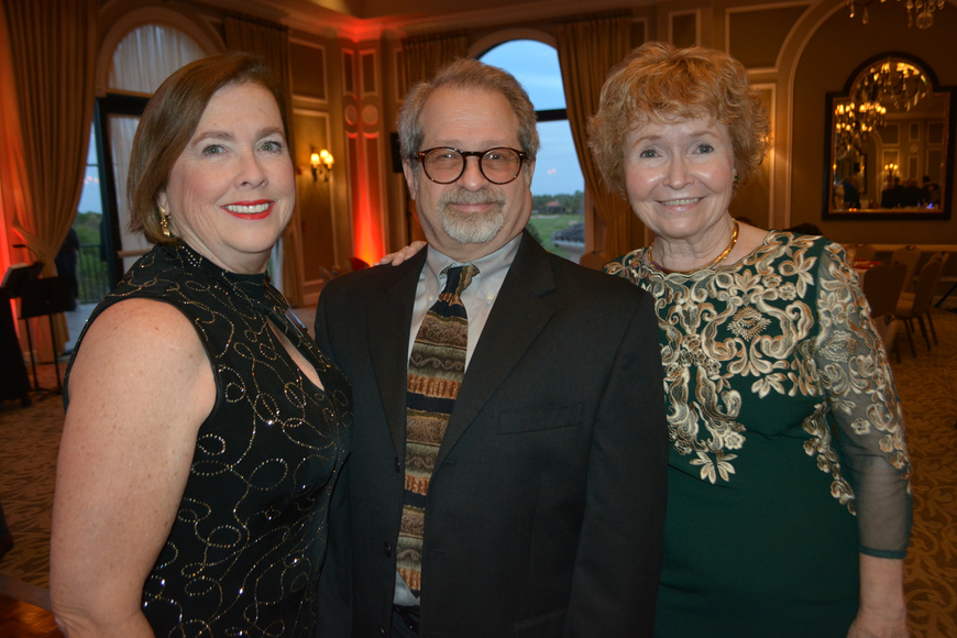 Players board member Donna DeFant, Elliott Raines of Two Chairs Theatre Company and Pam Wiley, a director at The Players, mingle before dinner.
