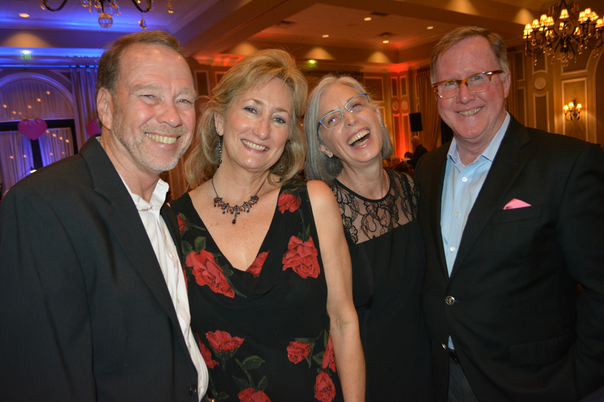 Lakewood Ranch Development's Bob Simons and his wife, Leigh, and John and Kathryn Hart share a laugh before the entertainment begins at Smitten.