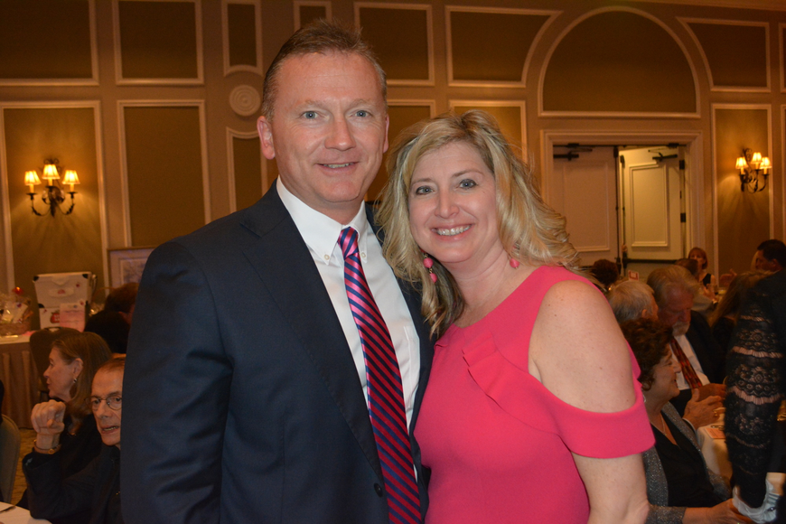 Clint Kasten and his wife, Heather Kasten, the executive director of the Lakewood Ranch Business Alliance, head to the dance floor at Smitten.