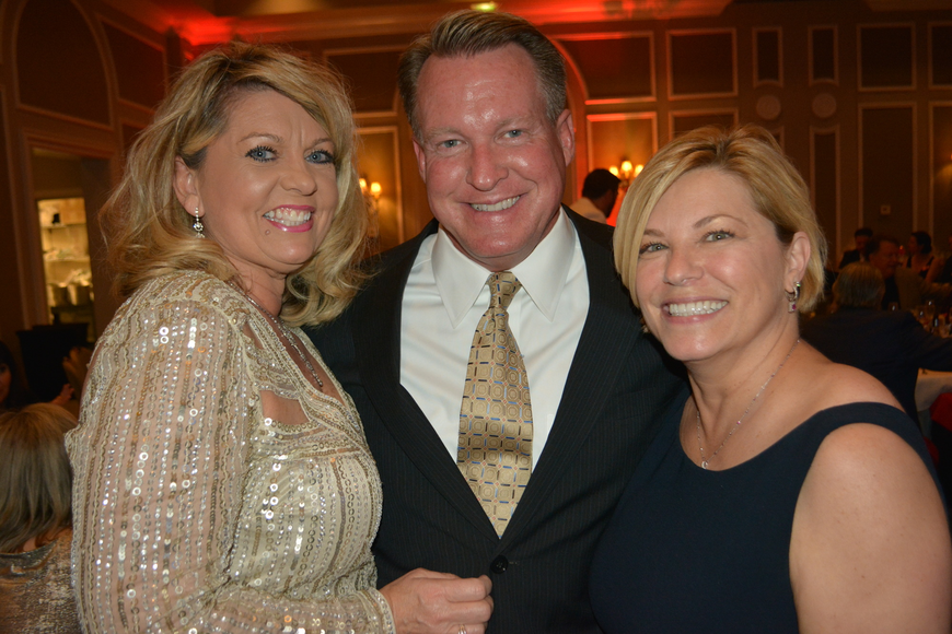 Peggy Kronus, Jerry Lamb and Angela Massaro-Fain share a laugh following dinner.