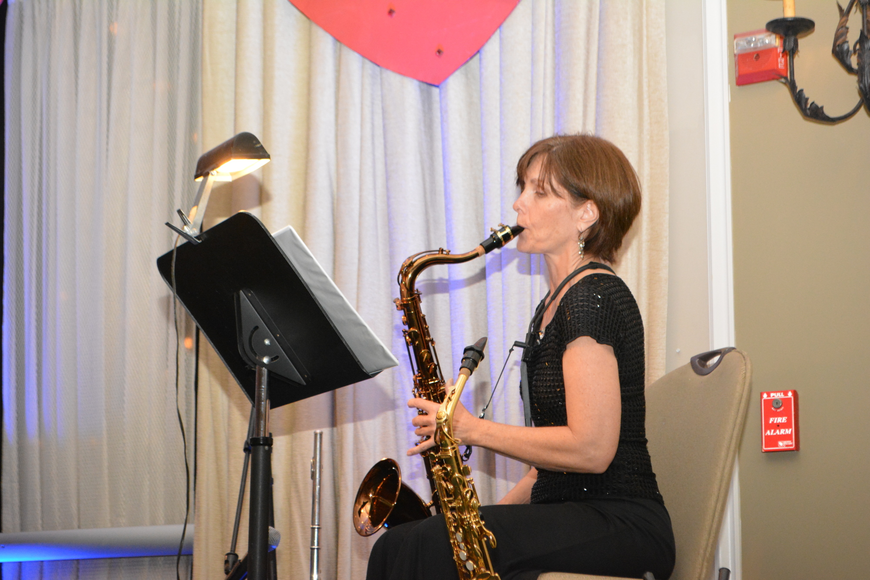 The Players' Teri Booth does a little wailing on the sax.